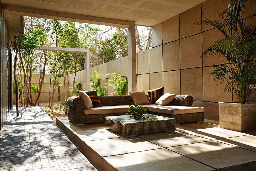 Shaded outdoor patios and greenery create a cool home staycation zone