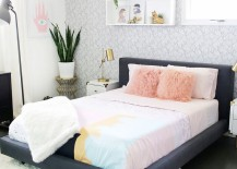 Shaggy rug and fluffy pillows add texture