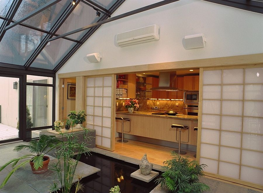 Shoji screen separates the sunroom from the kitchen indoors