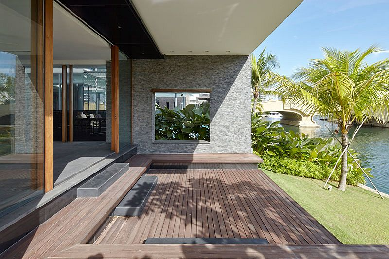Simple deck and landscape allows the homeowners to enjoy canal views