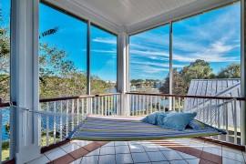 Simple screen and hammock fashion a beautiful sunroom