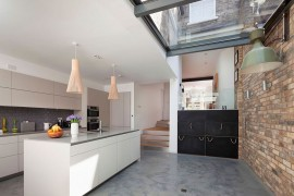Skylight for modern kitchen with brick feature wall