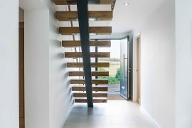 Sleek and stylish staircase leading to the master bedroom on the first level