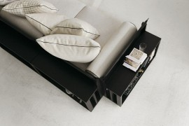 Sleek modular sofa with bookshelves and storage space