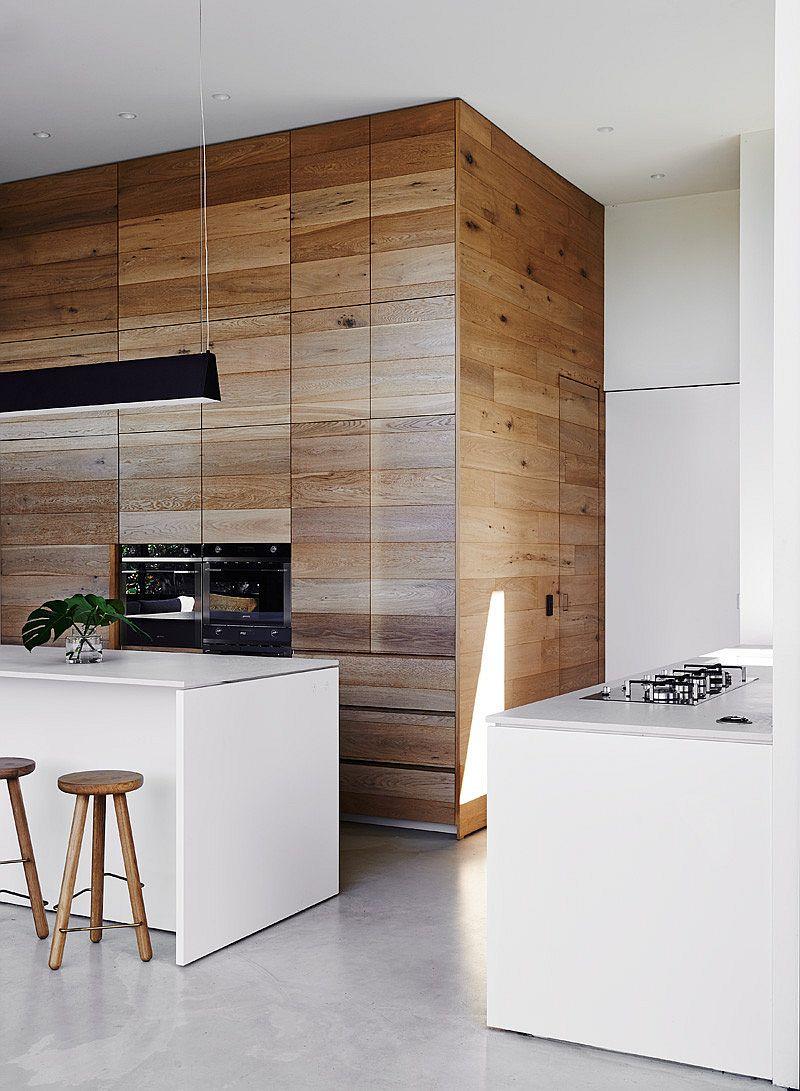 Sleek white kitchen island and a smart workstation