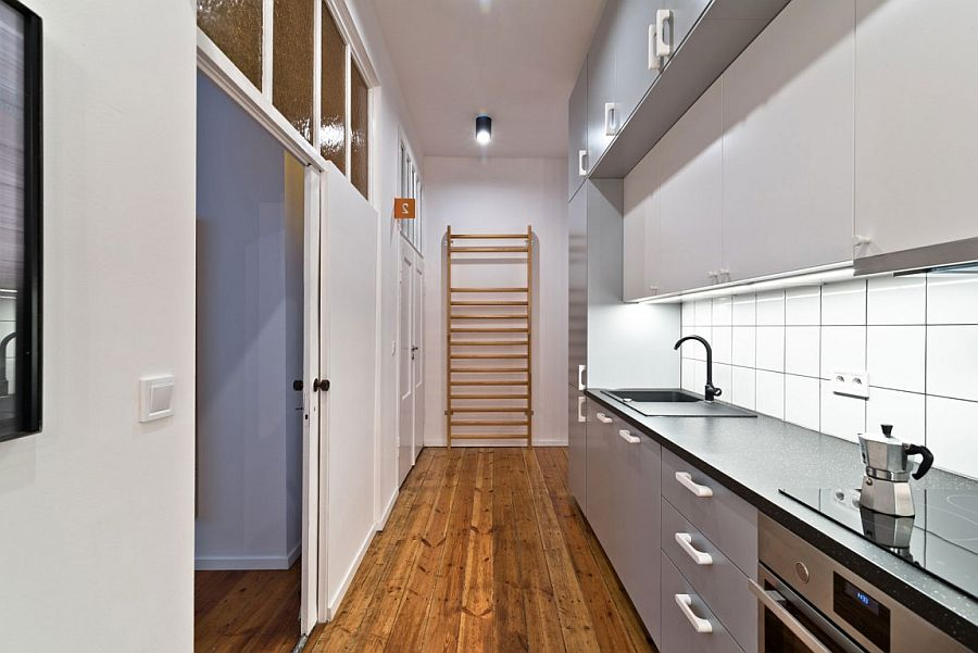 Sliding door inside the tiny apartment help maximize the foot space