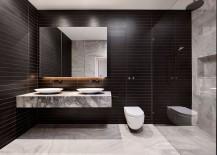 Slim floating quartzite bench top set against a dark backdrop in the bathroom