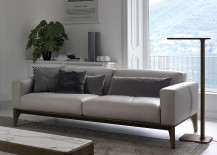 Slim floor lamp next to the sofa complements it perfecty
