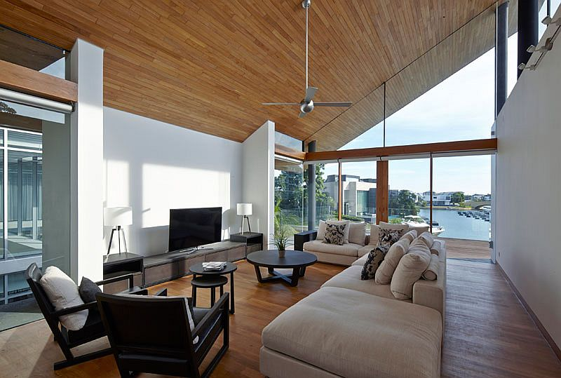 Sloped wooden ceiling adds a cool architectural twist to the interior
