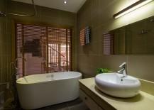 Small-modern-bathroom-with-a-gorgeous-freestanding-bathtub-217x155