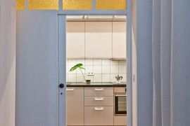 Small, narrow space in the Poznan apartment turned into kitchen and dining