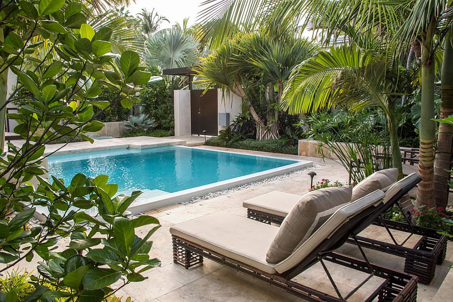 25 spectacular tropical pool landscaping ideas for Pool landscape design