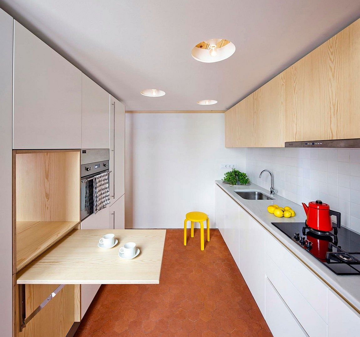 Space savvy kitchen and mezzanine in small barcelona apartment for Smart kitchen design small space