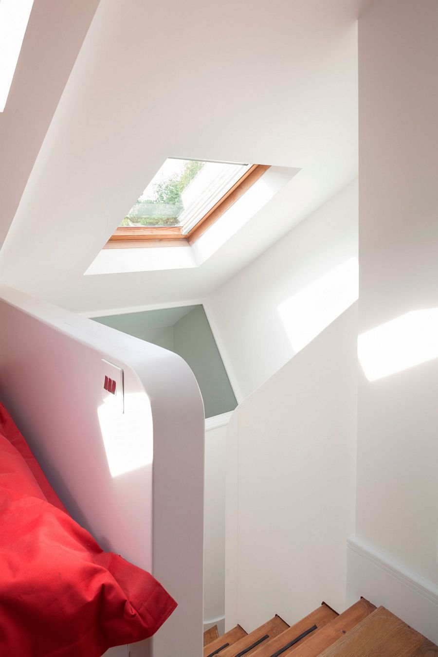 Smartly placed windows and skylights illuminate the loft space