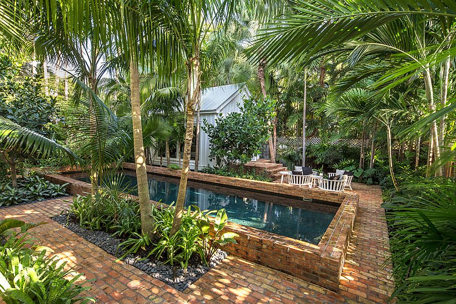 25 spectacular tropical pool landscaping ideas for Tropical landscape