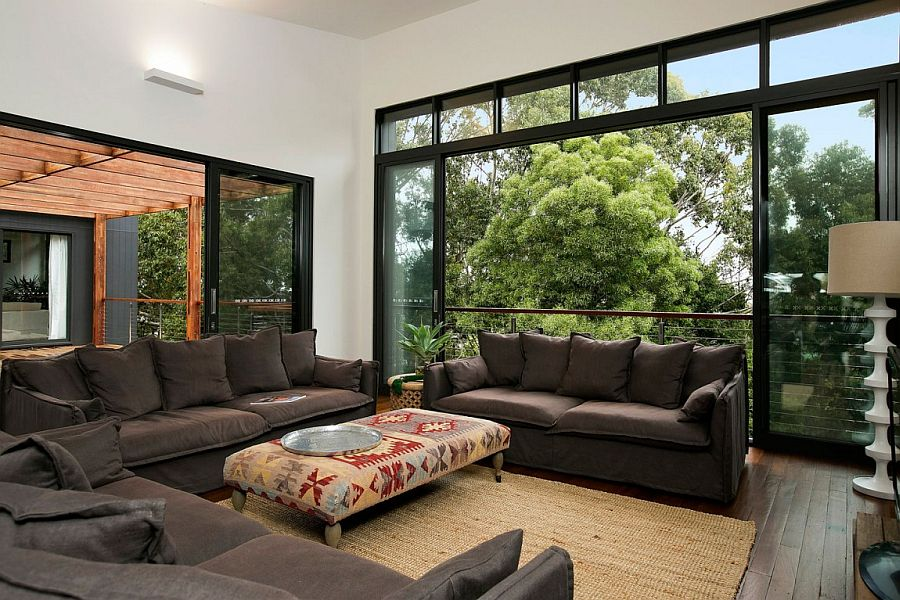 Spacious living area completely opens up to the bush outside