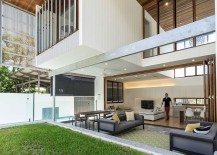 Stackable folding doors open up the interior to the lovely landscape outside 217x155 Backyard House in Brisbane Opens up a Light Filled Urban Nirvana
