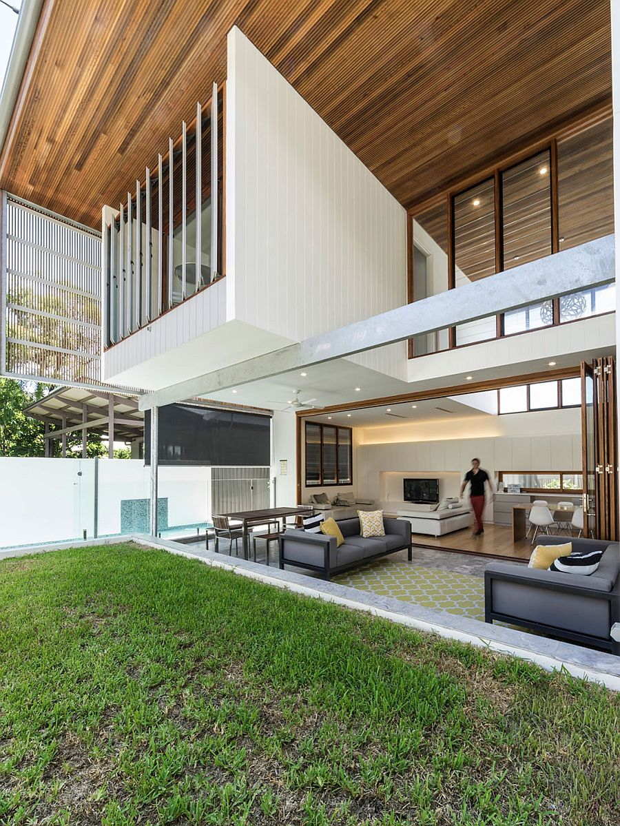 Stackable folding doors open up the interior to the lovely landscape outside
