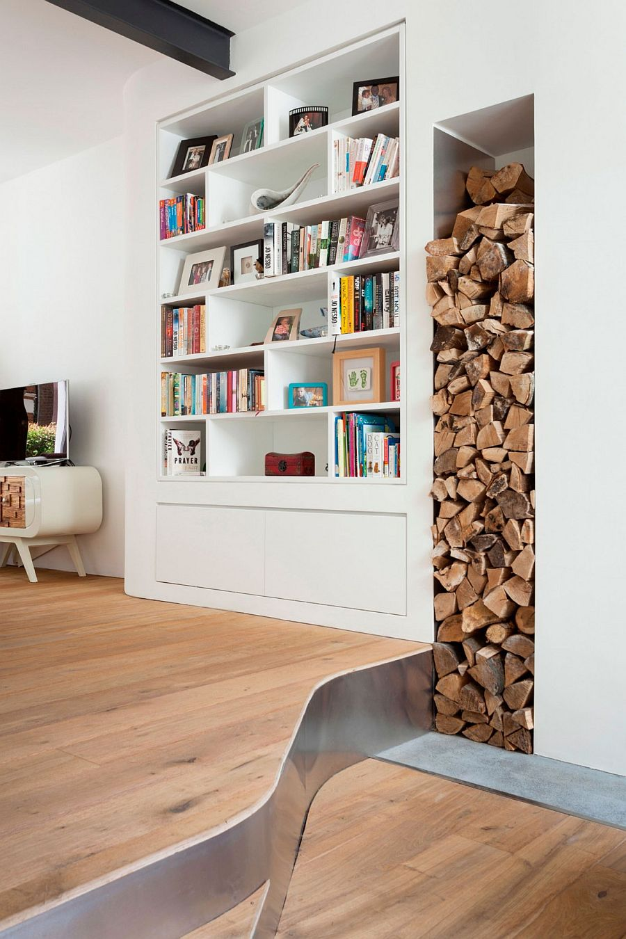 Stacked wood adds textural contrast to the interior