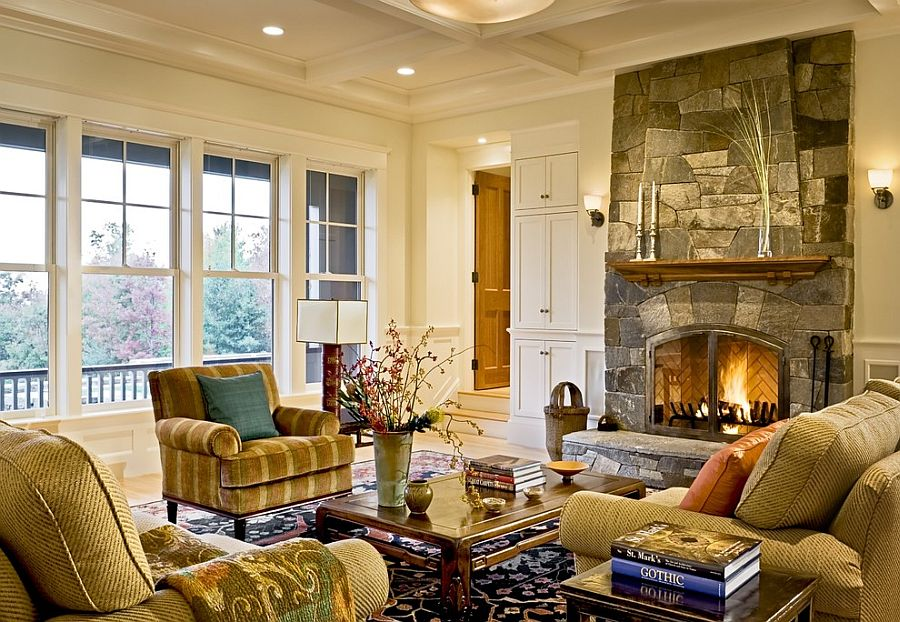 Stone fireplace and coffered ceiling create a cozy living room [From: Smith & Vansant Architects / Rob Karosis Photography]