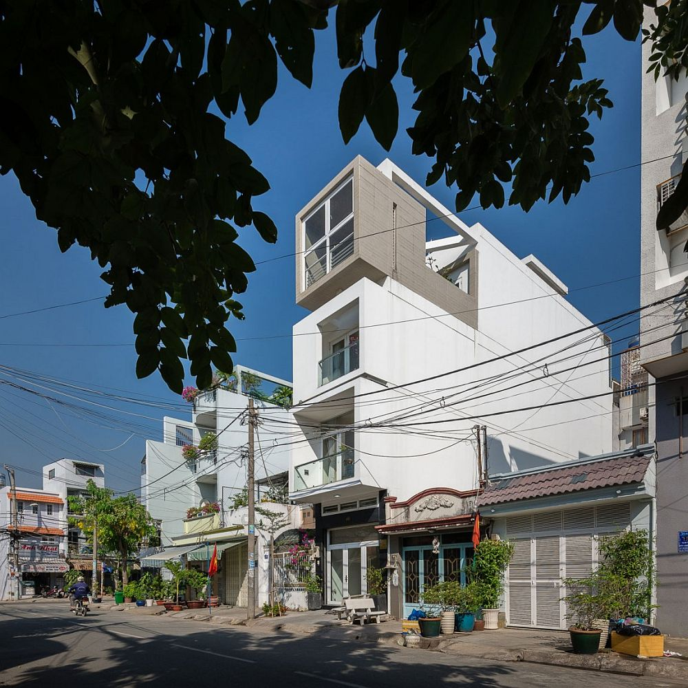 Street facade of narrow urban house in Ho Chi Minh city