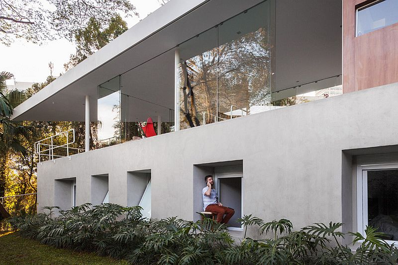 Structure of the home on sloped site creates a natural private zone