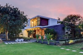 Stunning landscaped entry and reflective pond of contemporary farmhouse in Delhi