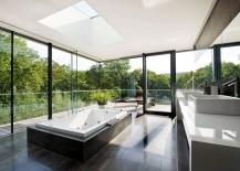 Stunning minimalist bathroom with framed glass walls