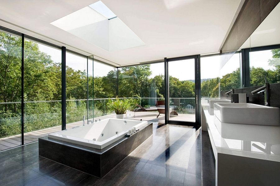 Stunning minimalist bathroom with framed glass walls