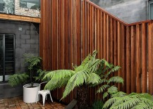 Stylish use of wooden slats combines privacy with textural beauty