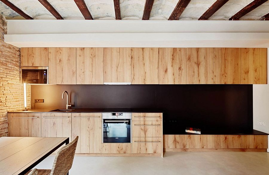 Stylish wooden cabinets add softness and modern elegance to the interior