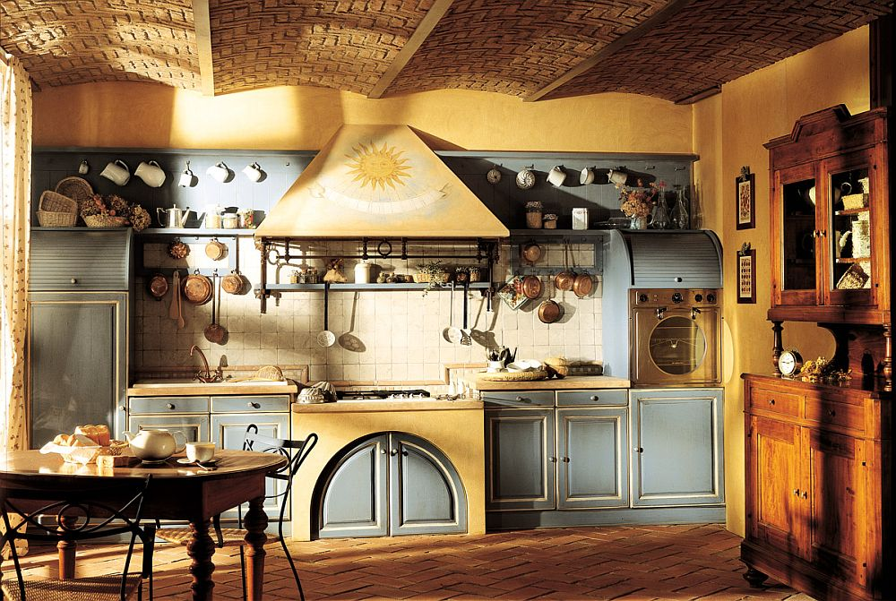 Sunburst motif on the hood drives home the Provencal Country style of the kitchen