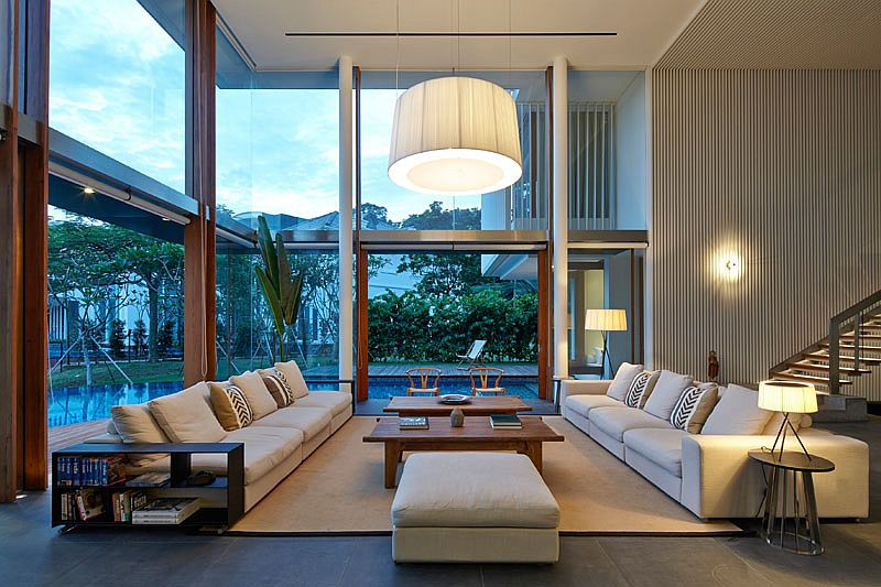 Swimming pool outside wraps itself around the spacious, open living room