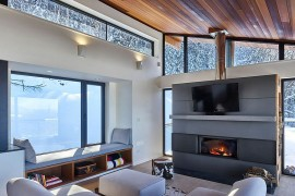 TV above the fireplace inside the stylish chalet