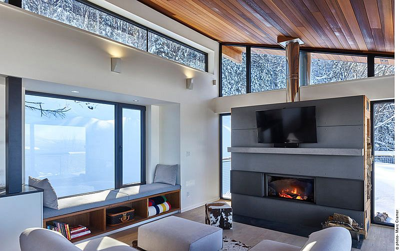 TV above the fireplace inside the stylish chalet