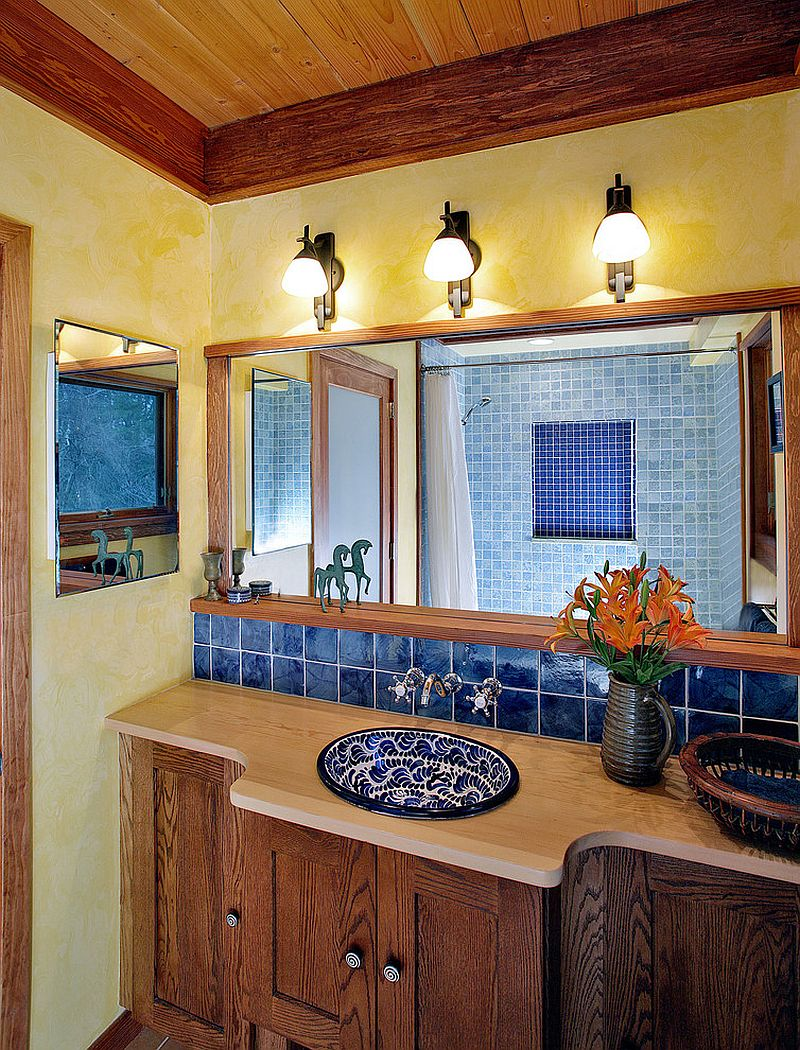 trendy twist to a timeless color scheme bathrooms in blue and yellow textured walls in yellow bring warmth to the mediterranean style bathroom design abrams design
