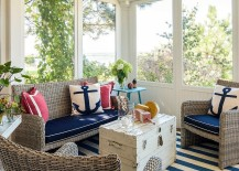 Throw pillows with nautical motif add to the elegance of the sunroom
