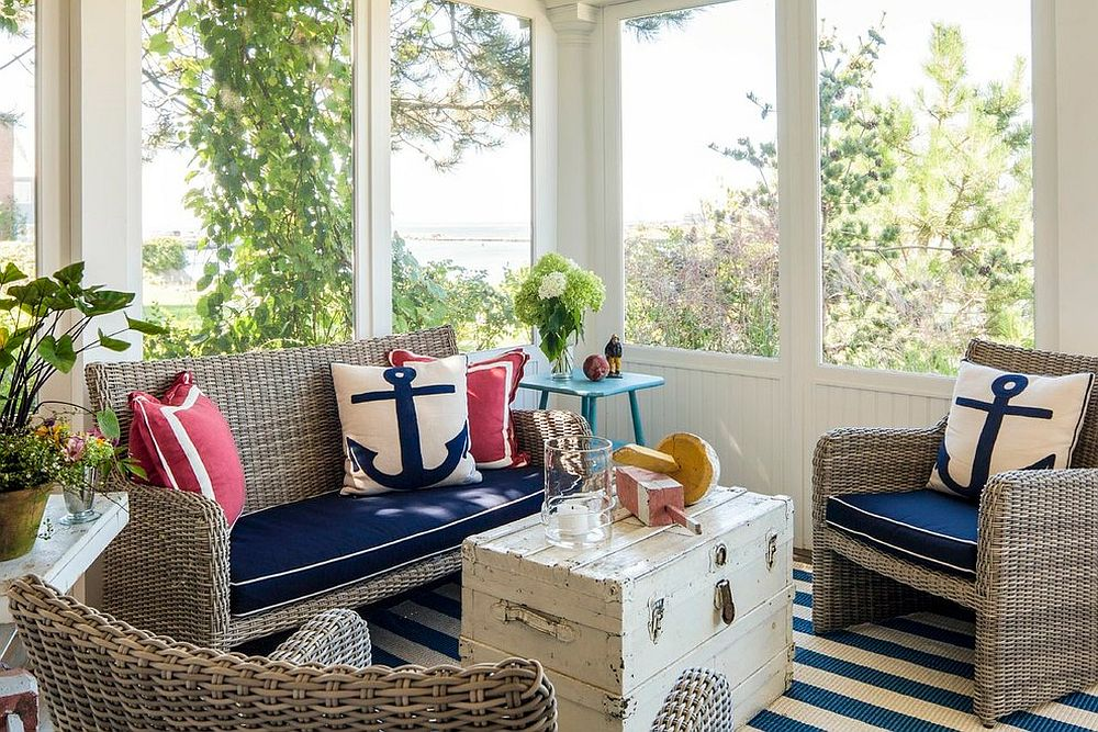 Throw pillows with nautical motif add to the elegance of the sunroom [Design: Hurlbutt Designs]