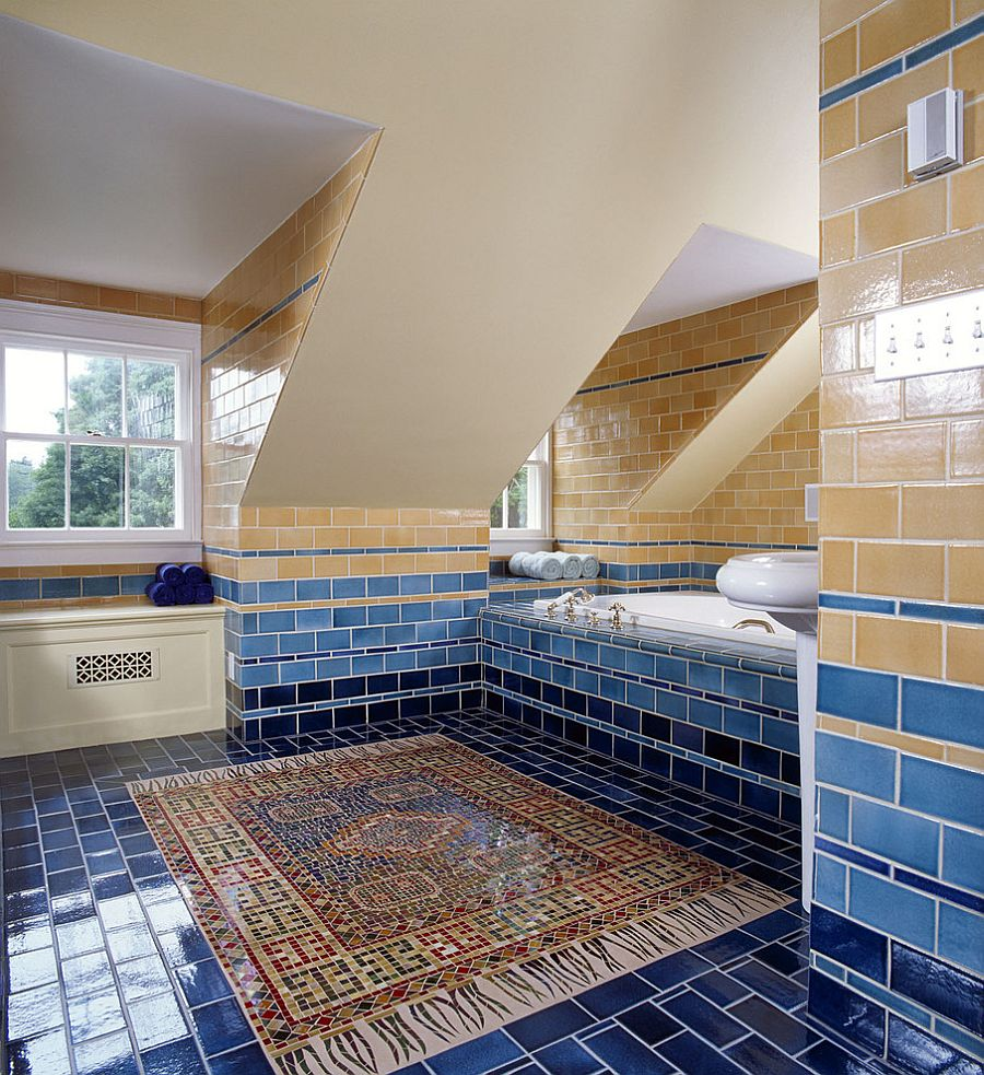 Tiled walls bring in various shades of yellow and blue into the bathroom [Design: Felhandler/ Steeneken Architects / Photography: Gridley & Graves]