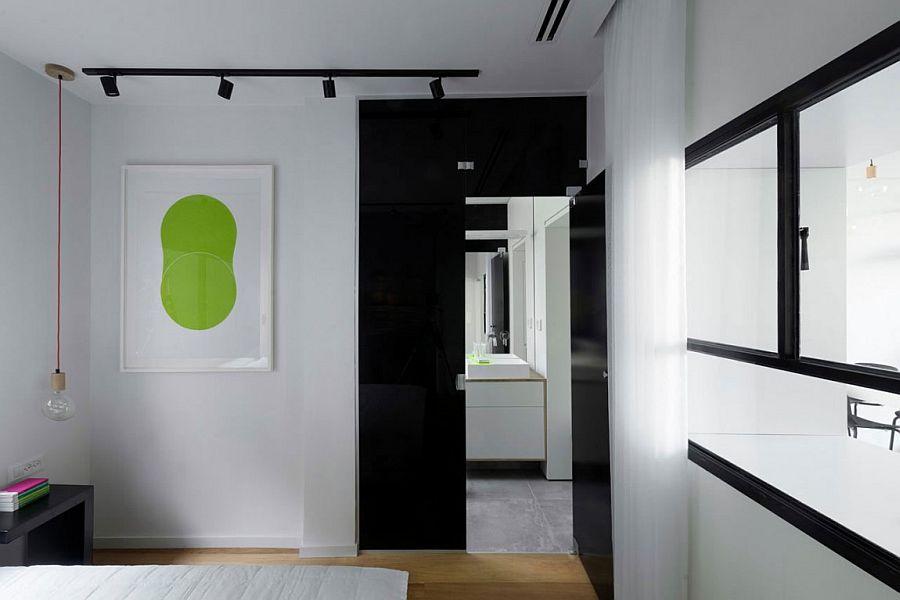 Tinted glass door connects the bedroom and the bathroom