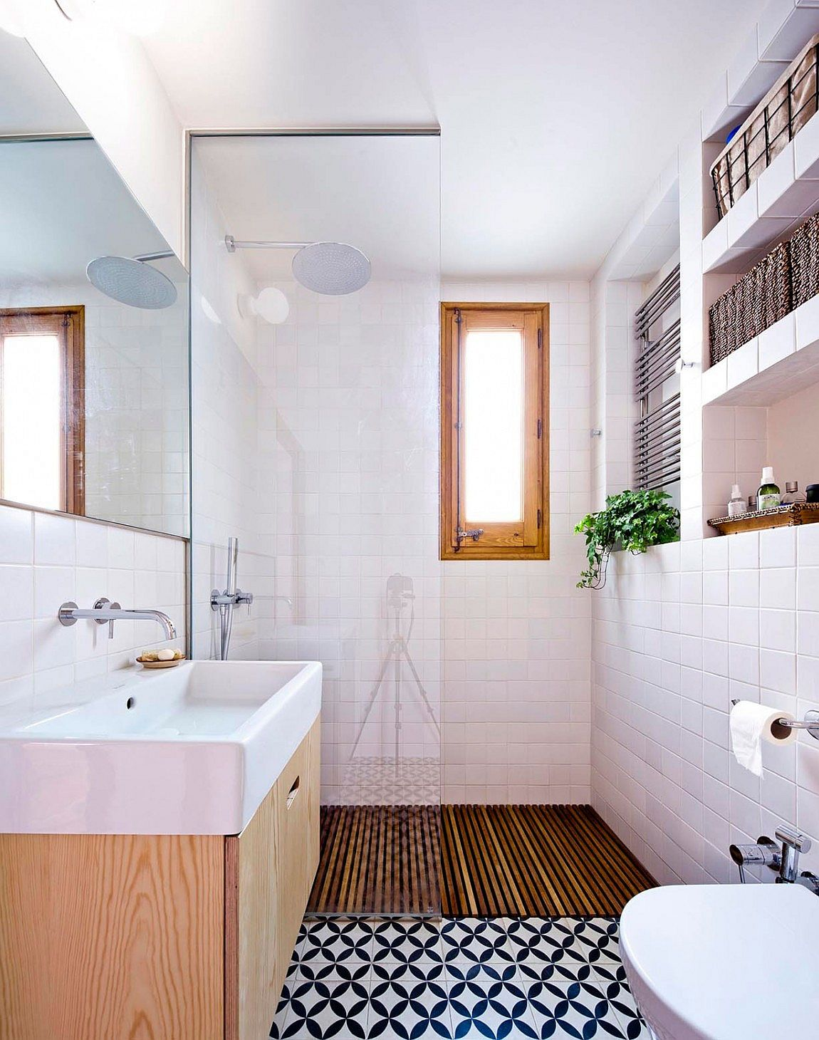 Tiny shower area and bathroom of the small apartment in Barcelona