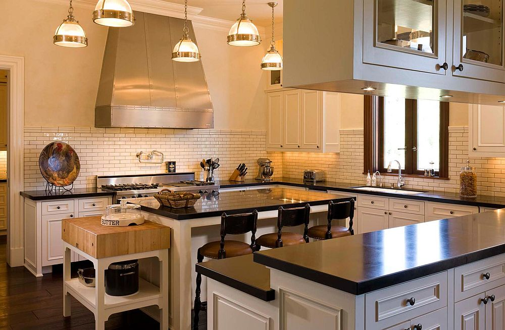Traditional kitchen in white with a small butcher block station next to the central island