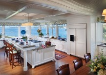 Traditional kitchen with ocean view and an island with breakfast counter