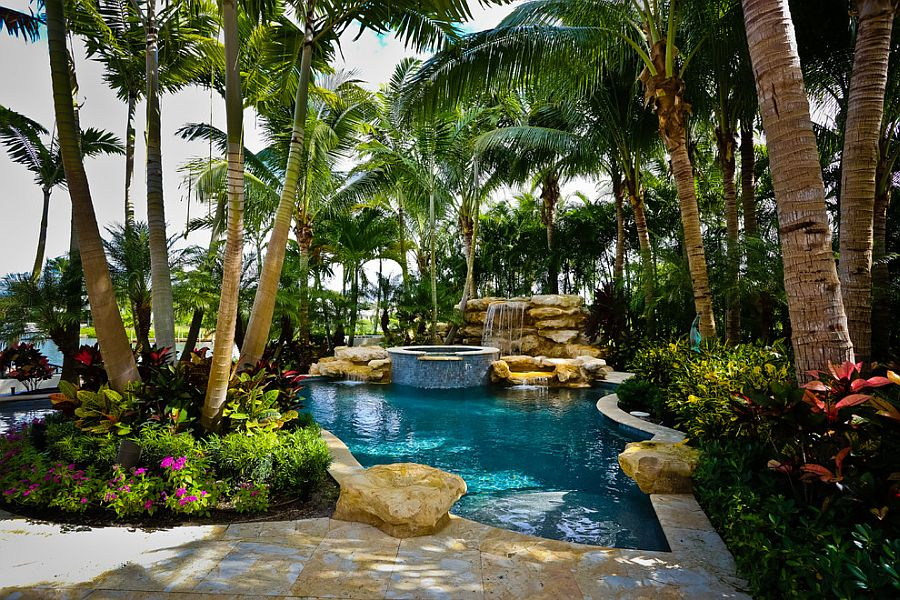 25 spectacular tropical pool landscaping ideas for Garden designs around pools