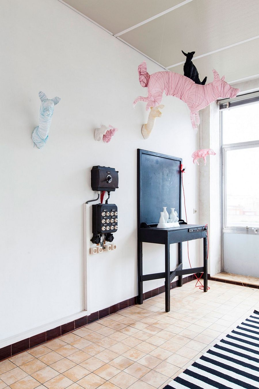 Unique, suspended animal figurines inside the Ghent apartment