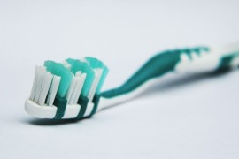 Use an old toothbrush to scrub away debris