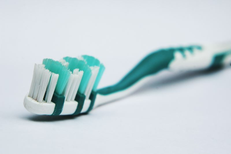 Use an old toothbrush to scrub away debris
