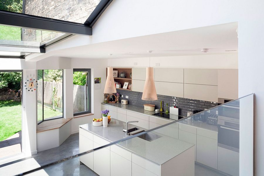 White and gray kitchen with large windows, Nelson clock and Seppo Koho lighting