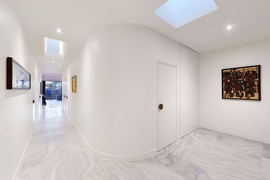 White corridors with curved wall and skylights
