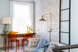 Whitewashed brick wall in the home office adds textural contrast without disturbing the color scheme